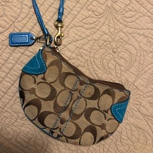 COACH turquoise and suede wristlet
